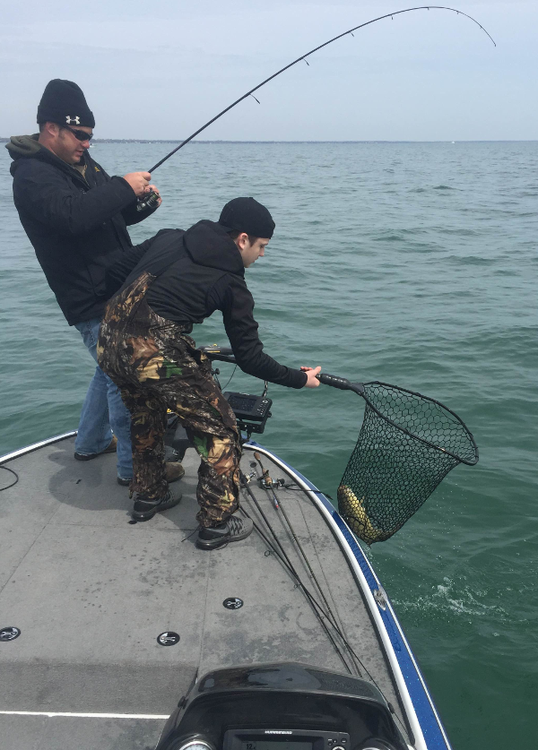 Zach Tolbert netting Gary Polenz fish